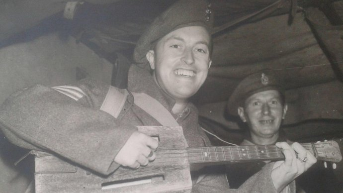 Tom with his ukulele after being repatriated to the UK